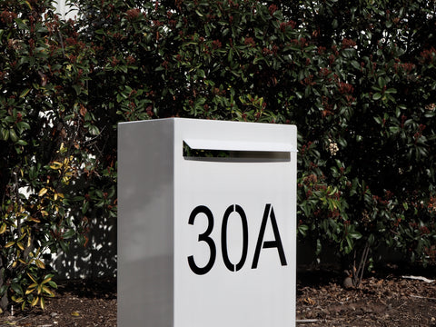 pearl white horizontal pillar with black vinyl numbers