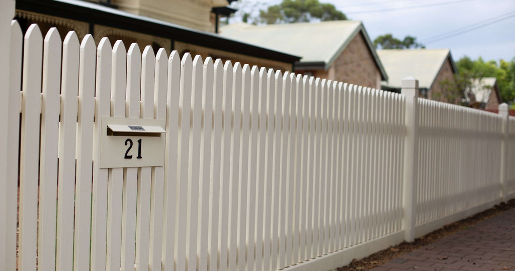 built in letterbox in picket fence
