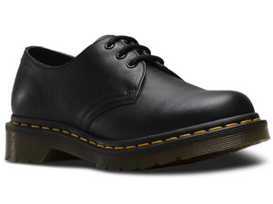 Black leather shoe with three eyelets and gum clear sole.  The yellow stitching that Dr. Marten's are know for is there as well. Great school uniform shoe.