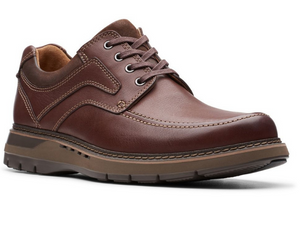 This casual brown leather walking shoe has a cushioned sole that is two toned brown.  A moccasin stitch on the top upper and nubuck on the padded collar and tongue.