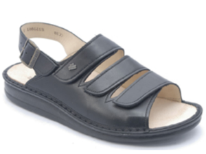 Flat black leather sandal with three velcro straps over the foot and one buckled strap around the heel.  Replaceable beige cork insole.