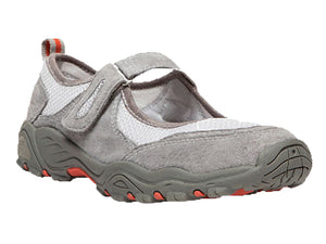 This light grey mary jane sneaker has a velco strap to adjust to the perfect fit.  Features a white mesh and light grey material with spots of orange in the sole and on the tab on the heel.