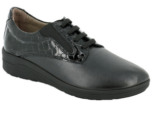 Black patent quilted leather lace up women's shoe with a plain stretchable front that accommodates feet problem like bunions, hammer toes, etc.  The twin gores at the side of the laces allow the foot to move if swollen or if needs a little more space without being loose.  Leather lined inside so feet can breath along with a cushioned bottom sole.  The problem solver shoe!