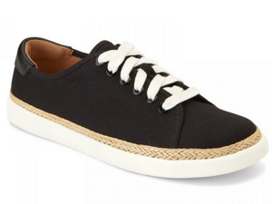 This canvas black upper is accented with a beige braid around the top of the sole.  The white thick laces with the white sole makes it a cute and fun shoe.