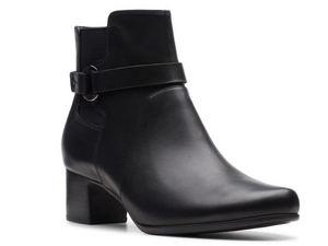 Black leather fall boot with smooth sleek design.  Inch and a half dress heel with strap around ankle and buckle.  Features side gore and side zip on other side.