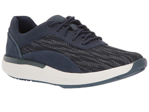 Sporty navy walking shoe with fabric blue and white textured upper and leather patches around heel, eyelets and arch.  The addition of the white sole and then navy rubber bottom make it look fresh and cool.