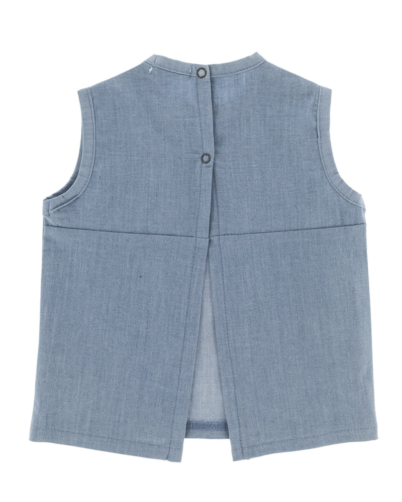 Organic cotton shortsleeve denim shirt for babies and toddlers, snaps at the back for easy changing. Open back.