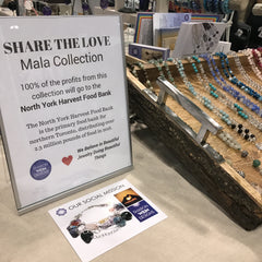 Share the love sign at a SharonWein Designs Gemstone Mala Beads booth