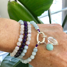 Load image into Gallery viewer, This mala necklace was created with beautiful 6mm Aquamarine, Moonstone, and Amethyst beads. It comes with a Crystal Quartz charm like the one pictured (other charms are for show only and can be purchased separately).