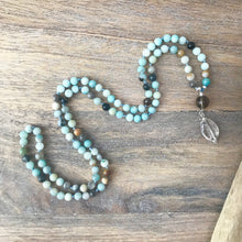 Load image into Gallery viewer, This Mala necklace features 6mm amazonite beads plus the guru bead which is made with a 10mm smoky quartz stone and a smooth larger crystal quartz all hand wired with .925 Sterling Silver.