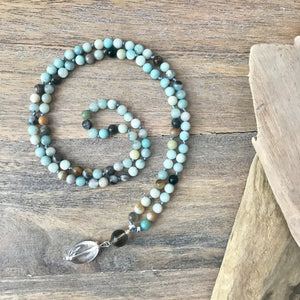This Mala necklace features 6mm amazonite beads plus the guru bead which is made with a 10mm smoky quartz stone and a smooth larger crystal quartz all hand wired with .925 Sterling Silver.