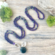 Load image into Gallery viewer, A beautiful necklace/mala to wear every day and a powerful tool with beautiful energy to remind you of your daily intentions. This faceted amethyst, moonstone and hematite mala beads necklace is made with 162 beads knotted every 3 stones (the equivalent of a mala and a half). It's a stunning, all around and timeless, boho accessory. Stones are 6 mm.
