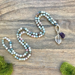 This multi-colour Beryl necklace is made with 108, 6-mm beads knotted every 3 stones with a strong nylon cord perfect to use as a meditation tool. The stones vary in color from deep blue to light pink, and everything in between. It's a beautiful boho accessory with stunning pastel color stones.