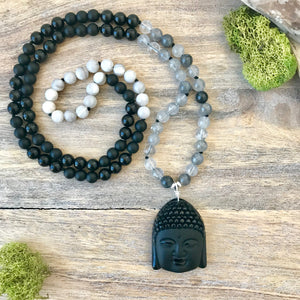 This amazing Mala necklace features 8mm matte and polished black obsidian, grey quartz and white lace agate gemstones and the Guru is a stunning large Buddha head carved from a large black obsidian from Mexico all hand wired with .925 Sterling Silver.