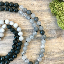 Load image into Gallery viewer, This amazing Mala necklace features 8mm matte and polished black obsidian, grey quartz and white lace agate gemstones and the Guru is a stunning large Buddha head carved from a large black obsidian from Mexico all hand wired with .925 Sterling Silver.