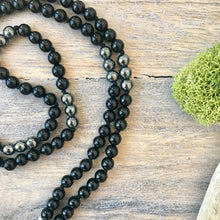 Load image into Gallery viewer, This Intention Mala was created with beautiful 6mm black onyx and hematite beads knotted every 3 stones with a strong nylon cord which can be used in your meditation practice. It's a smaller and shorter version for those who prefer a more delicate mala.