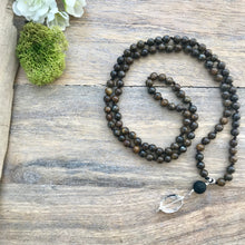 Load image into Gallery viewer, This Mala necklace features 6mm bronzite beads plus the guru bead which is made with a round lava bead followed by an oval crystal quartz bead, all hand wired with .925 Sterling Silver.