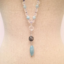 Load image into Gallery viewer, This Mala necklace is made of aquamarine,crystal quartz and a sterling silver bali bead.  It will help you be more courageous and brave by opening up the throat chakra. To read more about the properties of these stones, check out the Gemstone tab.