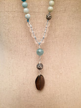"Load image into Gallery viewer, This Mala necklace is made of amazonite, smoky quartz, aquamarine, bali silver beads and silk. It measures 18.5"" long without the guru bead."
