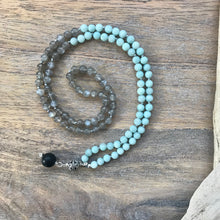 Load image into Gallery viewer, This Mala necklace features 6mm Grey Moonstone and Amazonite beads plus the guru bead which is made with a sterling silver carved Bali bead followed by an round matte black obsidian bead, all hand wired with .925 Sterling Silver.