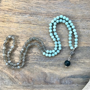 This Mala necklace features 6mm Grey Moonstone and Amazonite beads plus the guru bead which is made with a sterling silver carved Bali bead followed by an round matte black obsidian bead, all hand wired with .925 Sterling Silver.