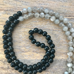This mala necklace features 6mm Grey Moonstone and and Black Obsidian beads. The guru is handwired with .925 Sterling Silver and features a Sterling Silver carved Bali bead followed by a round matte Black Obsidian bead.