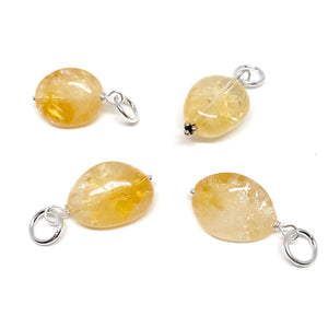 These naturally tumbled Citrine gemstones have been carefully wire wrapped with Sterling Silver and attached to a closed 7mm Sterling Silver jump ring. Perfect to add to a silver chain (will fit most necklaces and clasps) or for our Intention Malas. These have a special sterling silver clasp for adding your favourite stones and changing them as needed (see picture).