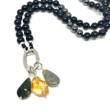 Load image into Gallery viewer, These tumbled Black Tourmaline gemstones have been carefully wire wrapped with Sterling Silver and attached to a closed 7mm Sterling Silver jump ring. They will fit most necklaces and most clasps.