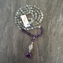 "Load image into Gallery viewer, This Mala necklace is made of grey moonstone, amethyst and crystal quartz. This Mala is lovingly knotted every three beads with natural silk. It measures 18"" long without the guru bead. The stones are 6mm."