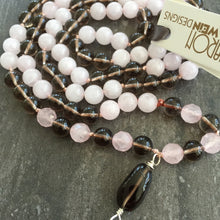 "Load image into Gallery viewer, This Mala necklace is made of pink quartz, smoky quartz, sterling silver and silk. It measures 18.5"" plus the guru bead."