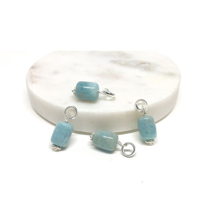 These natural tube-shaped Larimar gemstones have been carefully wire wrapped with Sterling Silver and attached to a closed 7mm Sterling Silver jump ring. Perfect to add to a silver chain (will fit most necklaces and clasps) or for our Intention Malas. These have a special sterling silver clasp for adding your favourite stones and changing them as needed (see picture).