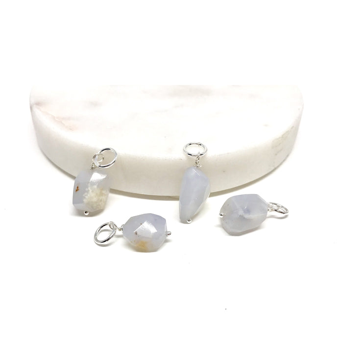 These natural faceted blue Chalcedony gemstones have been carefully wired wrapped with sterling silver and attached to a closed 7mm sterling jump ring. They will fit most necklaces and most clasps.
