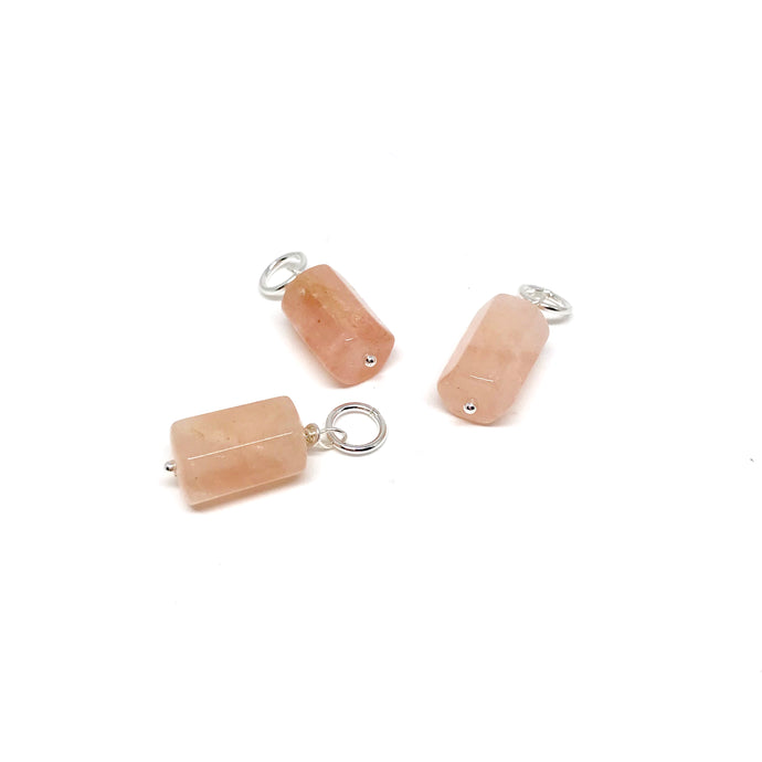 These natural hexagon tube-shaped Morganite gemstones have been carefully wire wrapped with Sterling Silver and attached to a closed 7mm Sterling Silver jump ring. They will fit most necklaces and most clasps.