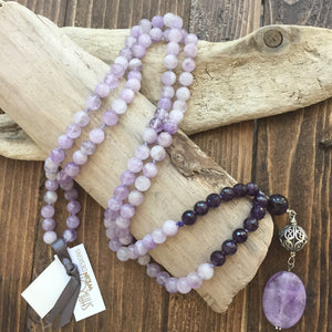 This mala is made with beautiful 8mm dark purple and lavender amethysts beads. The guru is made with a large round amethyst bead, sterling silver Bali bead and a smooth oval large lavender amethyst bead. Amethyst is a powerful and protective stone and a natural tranquilizer. It will help you to remain calm and focused making you more able to set realistic goals.