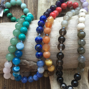 This 7 Chakra Japa Mala is created using 19 different types of Gemstones. Each one of the Chakras is represented by different stones representing the colors.