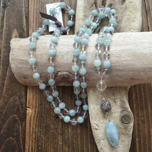 This Mala necklace is made of aquamarine,crystal quartz and a sterling silver bali bead.  It will help you be more courageous and brave by opening up the throat chakra. To read more about the properties of these stones, check out the Gemstone tab.