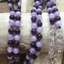 Load image into Gallery viewer, This Mala necklace is made with amethyst, lavender amethyst and a sterling silver bali silver bead. Amethyst is a beautiful and calming stone that will inspire you, protect you and sooth you wherever you need support.