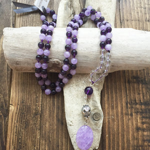 This Mala necklace is made with amethyst, lavender amethyst and a sterling silver bali silver bead. Amethyst is a beautiful and calming stone that will inspire you, protect you and sooth you wherever you need support.