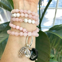 Load image into Gallery viewer, This mala necklace was created with beautiful 8mm Rose Quartz and Howlite beads. It comes with a Crystal Quartz charm like the one pictured (other charms are for show only and can be purchased separately).