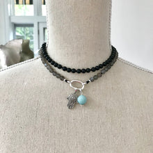 Load image into Gallery viewer, This mala necklace was created with beautiful 6mm Onyx and Moonstone beads, perfect for those who prefer a more delicate mala. It comes with a Crystal Quartz charm like the one pictured (other charms are for show only and can be purchased separately).
