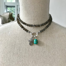 Load image into Gallery viewer, This mala necklace was created with beautiful 6mm Grey Moonstone beads. It comes with a Crystal Quartz charm like the one pictured (other charms are for show only and can be purchased separately).
