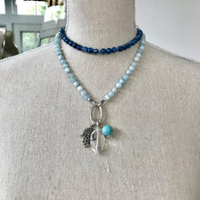 Load image into Gallery viewer, This mala necklace was created with beautiful 7mm Kyanite, Aquamarine, and Crystal Quartz beads. It comes with a Crystal Quartz charm like the one pictured (other charms are for show only and can be purchased separately).