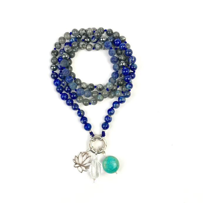 This mala necklace was created with beautiful8mm Lapis Lazuli, Larvikite, Labradorite, and Pyrite beads. This mala comes with a Crystal Quartz charm like the one pictured (other charms are for show only and can be purchased separately).