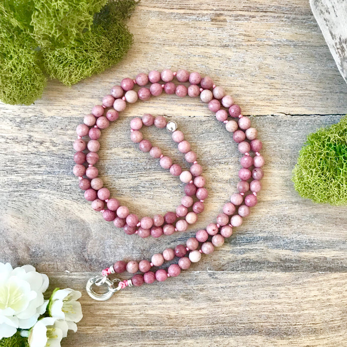 This Intention Mala was created with beautiful 6mm faceted rhodonite beads knotted every 3 stones with a strong nylon cord which can be used in your meditation practice. It's a smaller and shorter version for those who prefer a more delicate mala.