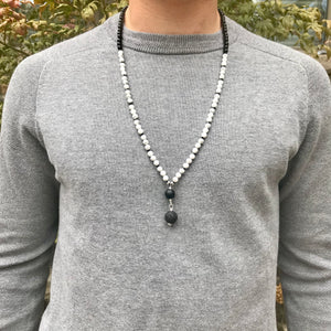 This Mala necklace features 6mm white howlite and black onyx beads plus the guru bead which is made with a round matte black obsidian bead and a large lava bead, all hand wired with .925 Sterling Silver.