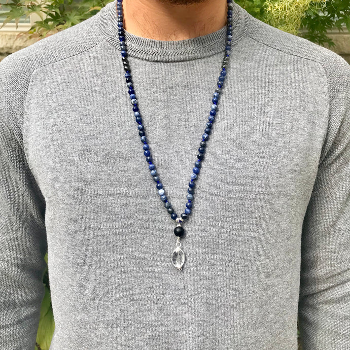 This Mala necklace features 6mm sodalite and hematite beads, plus a guru which is made with a round frosted black obsidian bead followed by a crystal quartz bead, all hand wired with .925 Sterling Silver.