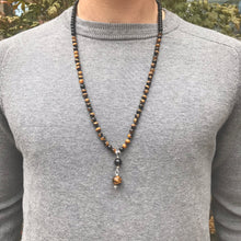 Load image into Gallery viewer, This Mala necklace features 6mm tiger eye and matte black obsidian beads plus the guru bead which is made with a smoky quartz bead followed by an round matte black obsidian bead, all hand wired with .925 Sterling Silver.