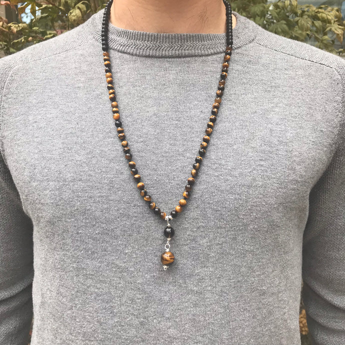 This Mala necklace features 6mm tiger eye and matte black obsidian beads plus the guru bead which is made with a smoky quartz bead followed by an round matte black obsidian bead, all hand wired with .925 Sterling Silver.