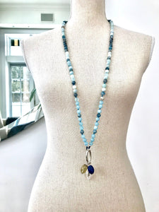 This mala necklace was created with beautiful 8mm matte and polished Aquamarine beads in different hues. It comes with a Crystal Quartz charm like the one pictured (other charms are for show only and can be purchased separately).