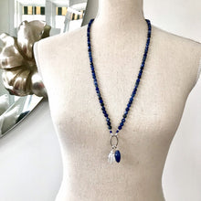 Load image into Gallery viewer, This mala necklace was created with beautiful 6mm Soldalite beads with a Sterling Silver bead at the midpoint. It comes with a Crystal Quartz charm like the one pictured (other charms are for show only and can be purchased separately).